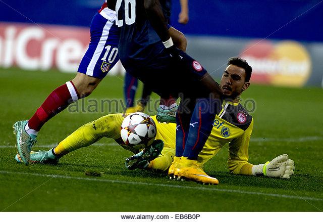 Madrid. 26th Nov, 2014. SPAIN, Madrid: Atletico de Madrid's Turkish midfielder Arda Turan and Olympiacos Spanish - Stock Image