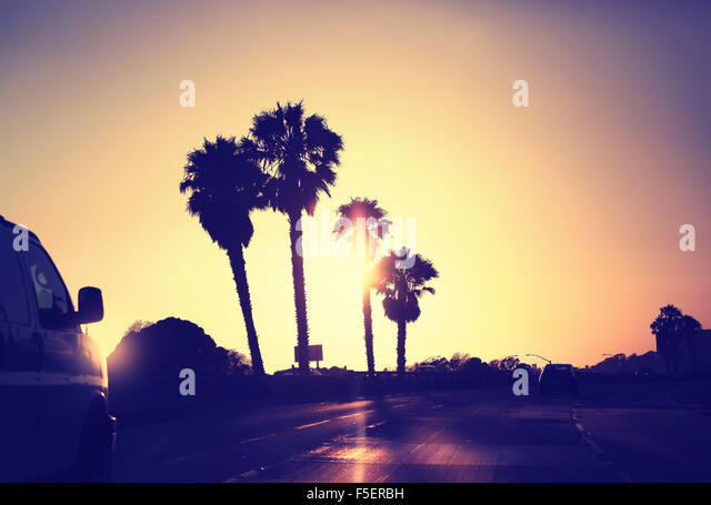 Vintage stylized picture of road against sunset, California, USA. - Stock-Bilder