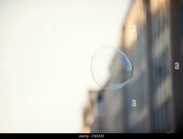 A bubble floating in an urban environment - Stock-Bilder