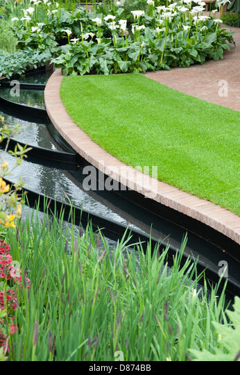 London, UK. 20th May 2013. The East Village Garden designed by Marie-Louise Agius at the RHS Chelsea Flower Show, - Stock Image
