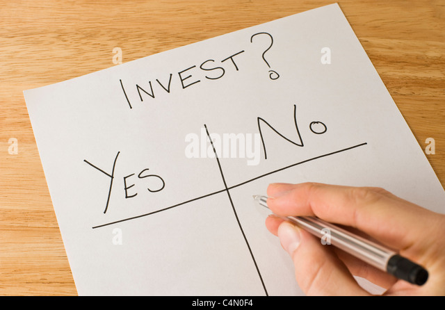 Business man making the decision of whether or not to invest - Stock Image