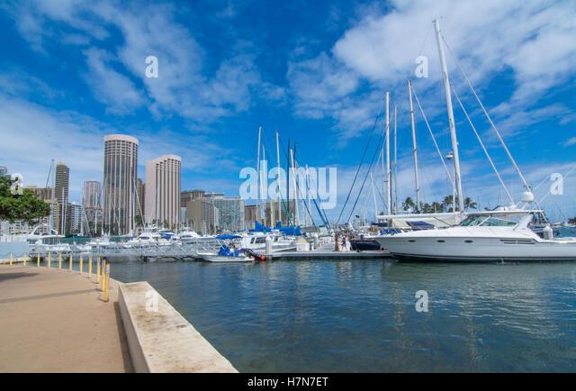 Honolulu Hawaii Oahu skyline from boat marina boating in Yacht Club - Stock Image