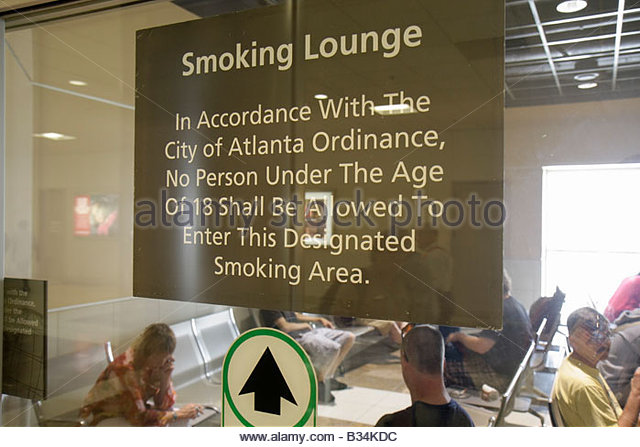 Atlanta Georgia Hartsfield-Jackson Atlanta International Airport smoking lounge vice addiction restriction warning - Stock Image