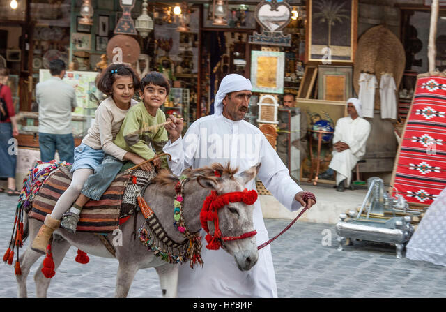 Qatar Doha Souk , children on donkey - Stock Image