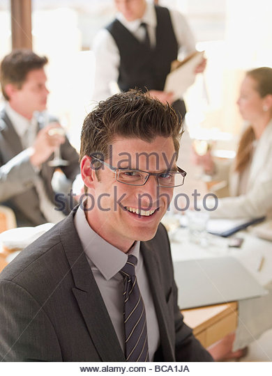 Business people having working lunch - Stock Image