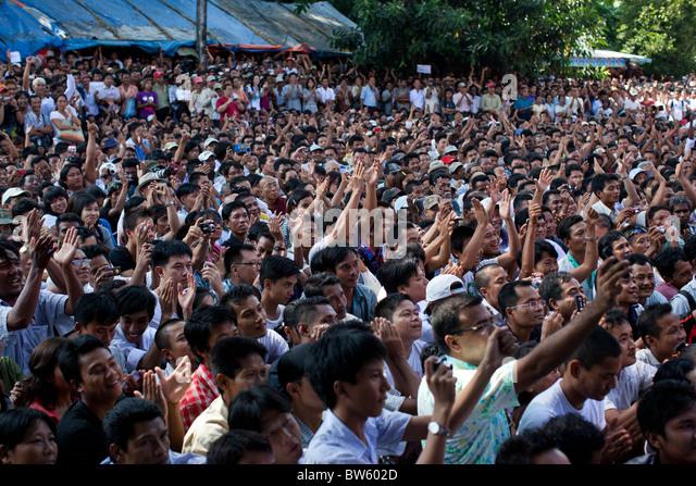 Supporters of Aung San Suu Kyi gather outside NLD head quarter as Aung San Suu Kyi addresses to them on Nov 14, - Stock-Bilder