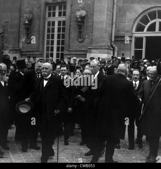 Premier Georges Clemenceau, President Woodrow Wilson, Prime Minister Lloyd George leaving the Palace of Versailles - Stock Image