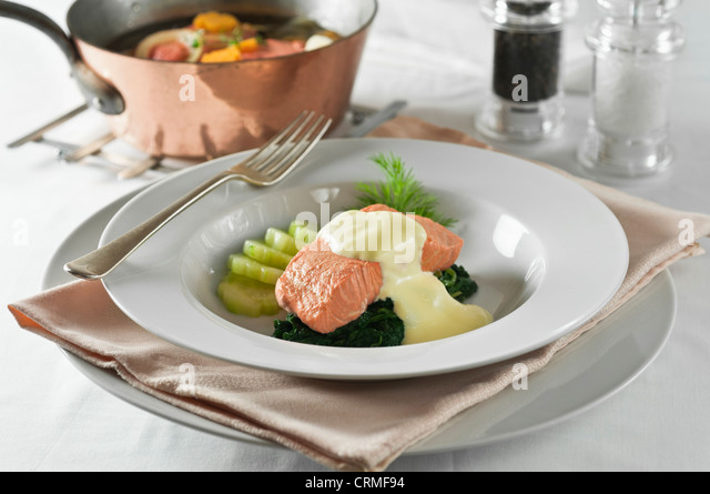 Poached salmon Hollandaise sauce - Stock Image
