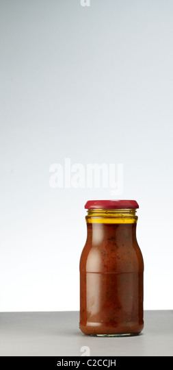 jar of pasta sauce with no label - Stock Image