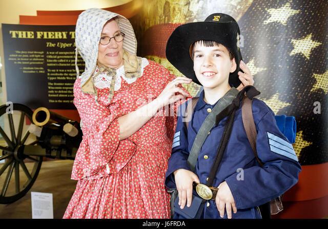 Wisconsin Kenosha Civil War Museum Civil War Days Park City Grays militia uniform Union woman boy education living - Stock Image