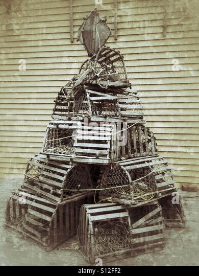 Lobster traps piled to resemble a Christmas tree. - Stock Image