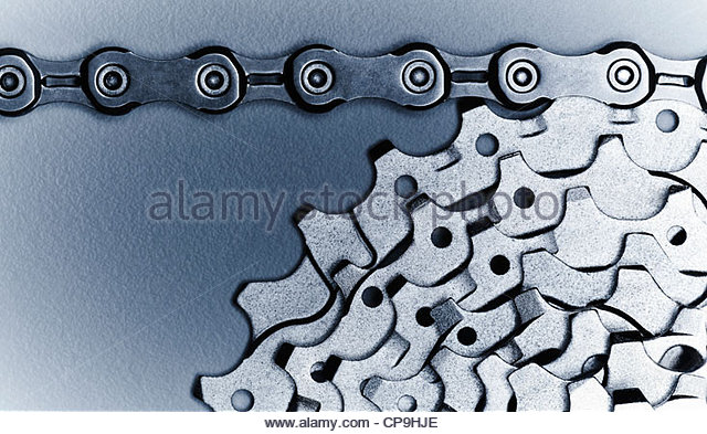 bicycle chain,bicycle gear,black and white,chain,close up,cog,gear,horizontal,link,metal,no people,photography,silver,studio - Stock Image