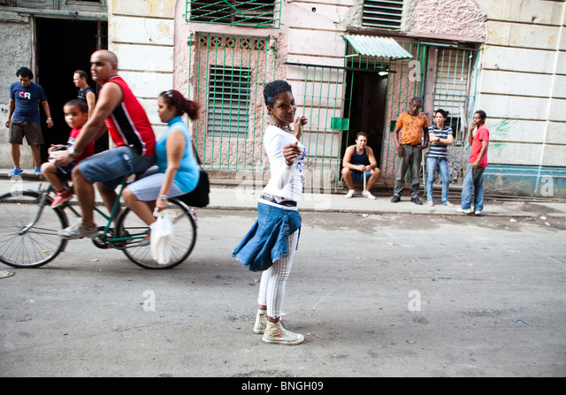 A girl dances in the streets of Havana Cuba - Stock Image