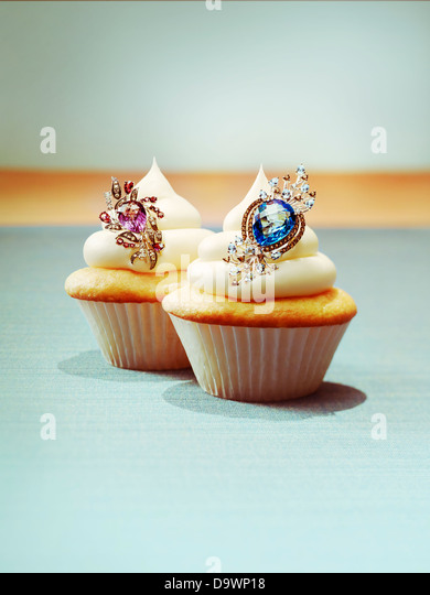 Cupcakes with jewelry - Stock Image