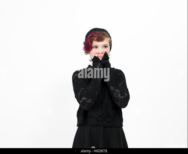 Teen pixie girl posing in studio. - Stock Image