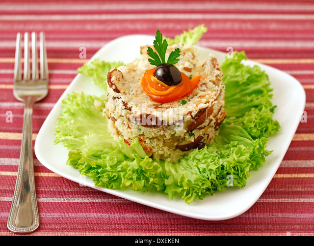 Cauliflower couscous with mushrooms. Recipe available. - Stock Image