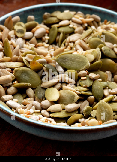 Blue bowl of various seeds mixture - Stock Image