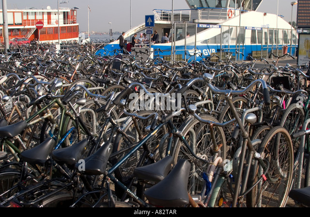 Amsterdam bicycles near the main station at the ferry pier - Stock Image