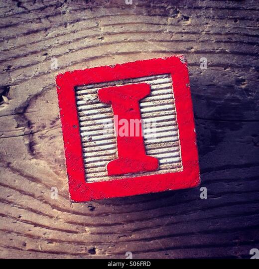 It's a woodblock toy with an alphabet letter on it: I - Stock Image
