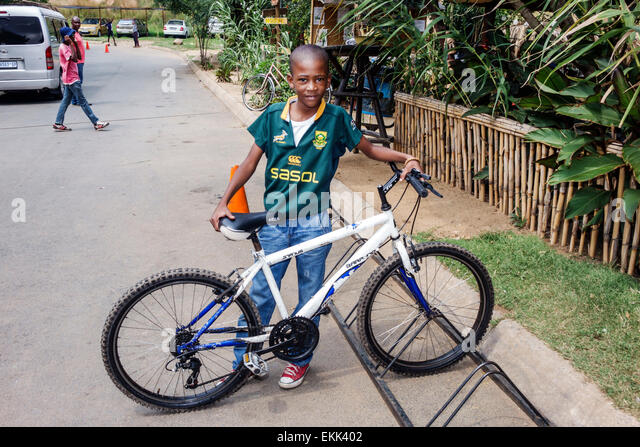 South Africa African Johannesburg Soweto Black boy bicycle bike - Stock Image