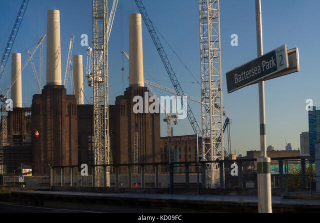 Battersea Park Railway station sign with the famous power station in the background - Stock Image