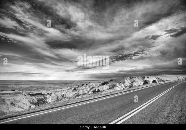 Black and white desert road, travel concept, USA. - Stock-Bilder