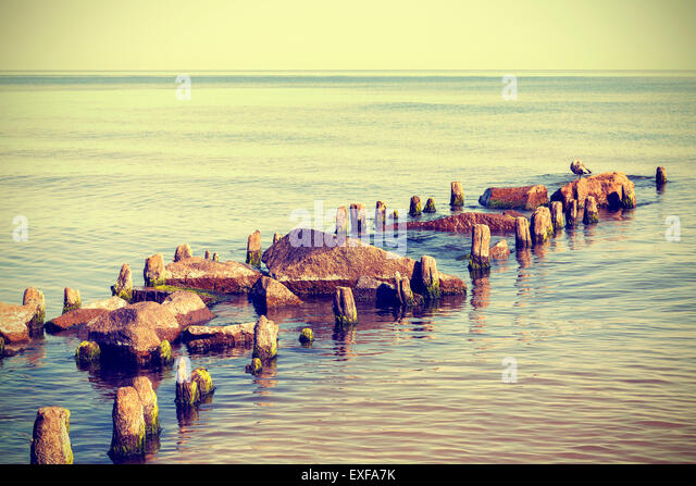 Retro vintage style photo of a beach, nature peaceful background. - Stock Image