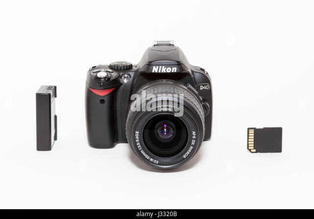 35mm Nikon D40 DSLR camera with battery and SD card on a white background - Stock Image