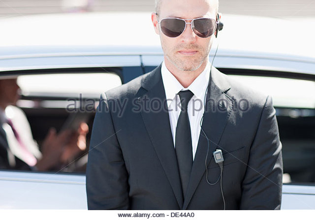 Bodyguard wearing earpiece - Stock Image