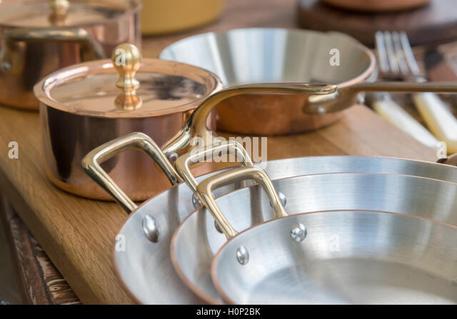copper pots and pans stock photos copper pots and pans. Black Bedroom Furniture Sets. Home Design Ideas