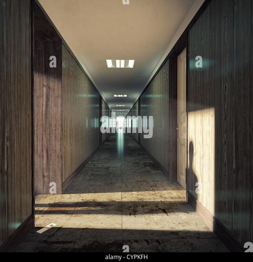 Open door  in a dark corridor. - Stock Image