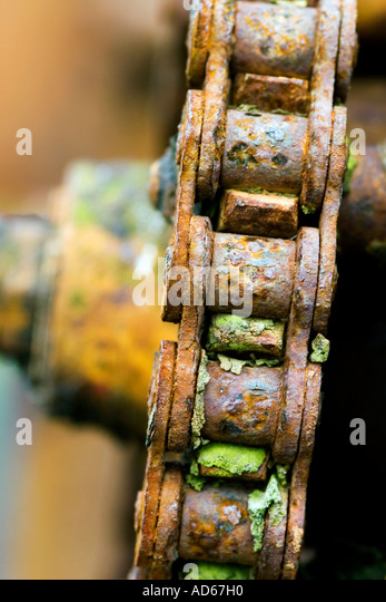 Close-up rusted chain, part of old farm machinery. Scotland - Stock Image