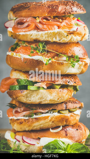 Close-up of Bagels with salmon, eggs, vegetables, capers, cream-cheese, herbs - Stock Image