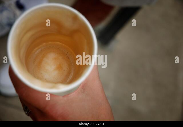 Empty coffee cup with residual foam - Stock Image