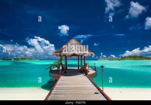 Traditional boat jetty in a luxury resort of Maldives, Indian Ocean - Stock-Bilder