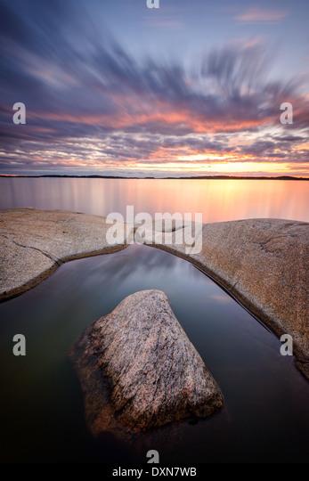 Sunset on idyllic ocean - Stock Image
