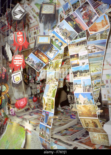 Tourist postcards blow in the wind at a newspaper stand in Tunis, Tunisia, North Africa - Stock Image