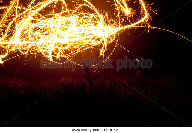 Pattern in sky from sparklers - Stock Image