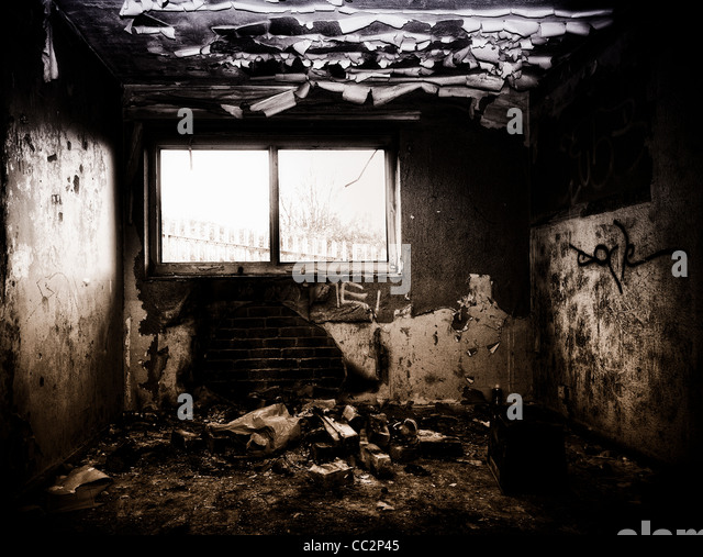 Burnt out room in a derelict building - Stock Image