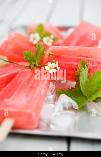 Homemade rhubarb strawberry popsicles - Stock Image