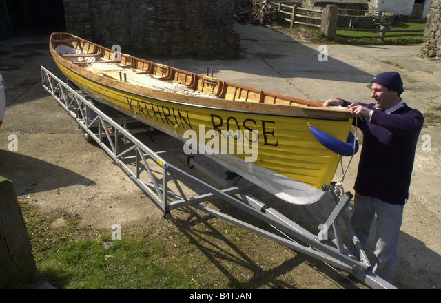 Tom Sutton of the Porthgain rowing club with the Kathrin Rose a six oared pilot gig The first in Pembroke 8th March - Stock Image