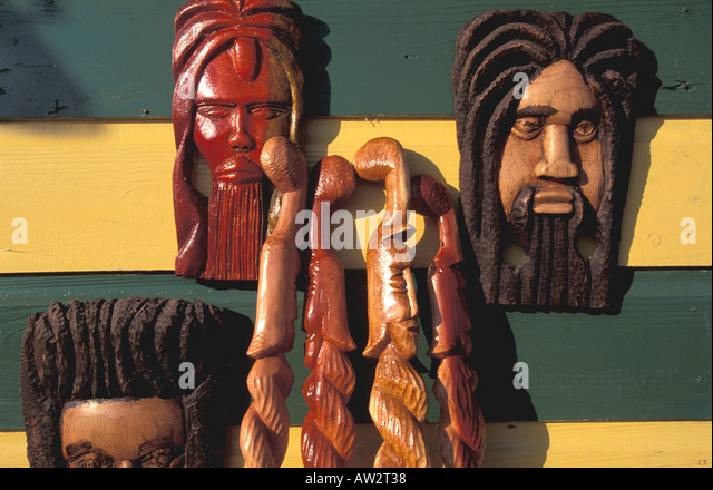 Jamaica Negril Wood Carvings at Roadside Stand - Stock Image