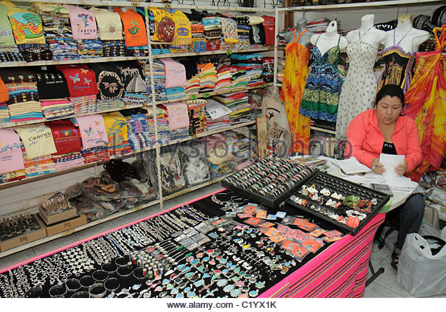 Cancun Mexico Yucatán Peninsula Quintana Roo Beach Hotel Zone Avenida Kukulkan Hispanic woman sales clerk store - Stock Image
