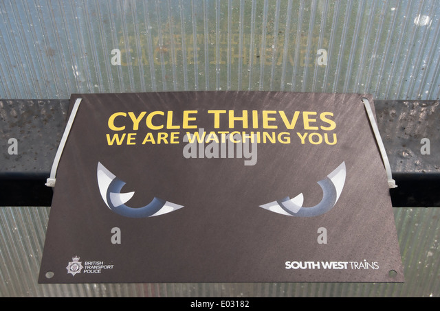 cycle thieves we are watching you, notice by british transport police and southwest trains at above a railway station - Stock Image
