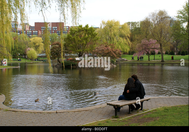A couple sitting in Boston Public Garden - Stock Image