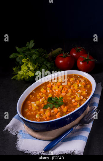 fish with vegetables in tomato sauce - Stock Image