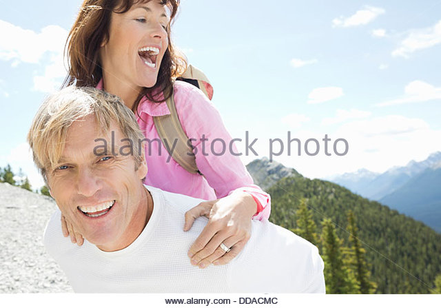 Active couple having fun outdoors - Stock Image