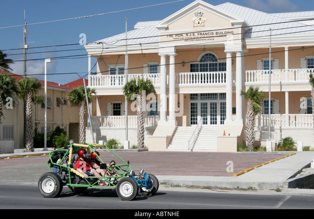 Grand Turk Cockburn Town Queens Street Francis Building Parliament government dune buggy tour - Stock Image