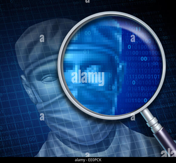 Doctor review and searching online for a medical specialist health care concept as a magnifyiing glass focusing - Stock Image