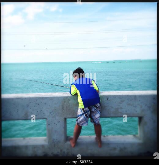 Little boy fishing - Stock Image